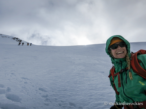 On the snowy face, heading up.